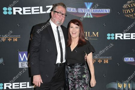 Stock Photo of Chris Haston, left, and Kate Flannery arrive at the 24th Family Film Awards at Universal Hilton Hotel, in Los Angeles
