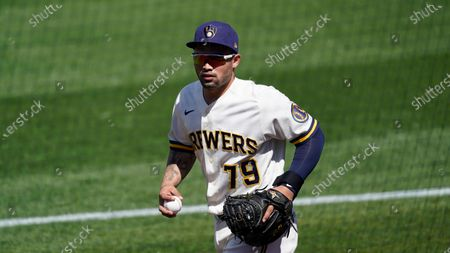 Milwaukee Brewers catcher Mario Feliciano (79) walks to the dugout before a spring training baseball game against the Colorado Rockies, in Phoenix