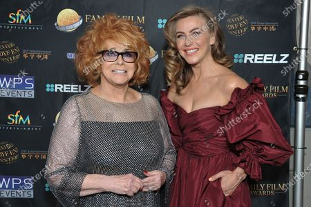 Ann-Margret, left, and Julianne Hough pose backstage at the 24th Family Film Awards at Universal Hilton Hotel, in Los Angeles