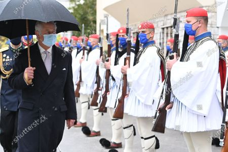 Prince Charles at the Presidential Guard Barracks and is greeted by The Commander of the Presidential Guard