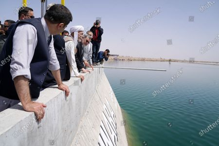 Afghan President Mohammad Ashraf Ghani (C) visits Kamal Khan Dam in Chahar Burjak district, Nimroz Province, Afghanistan, on March 24, 2021. Ghani on Wednesday inaugurated the key hydropower dam in Nimroz, which is expected to boost economy and agriculture in the land-locked Asian country, the state-run National Radio Television Afghanistan (RTA) reported.