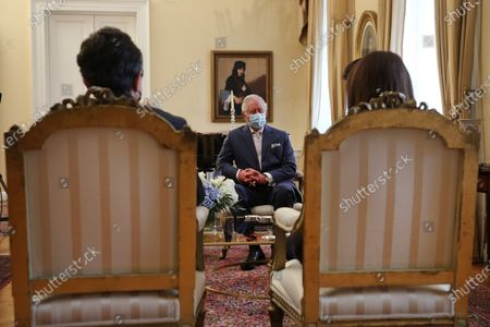 Greek President Katerina Sakellaropoulou (R) and her partner Pavlos Kotsonis (L) speaks with the Prince of Wales, Charles (C) and  the Duchess of Cornwall Camilla (not seen) during their meeting, in Athens, Greece, 25 March 2021, on the anniversary of the Greek Revolution. The anniversary events for the 200 years since the Revolution of 1821 are held with all formalities and the strict observation of all health protection measures against the coronavirus.