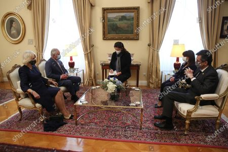 Greek President Katerina Sakellaropoulou (2-R) and her partner Pavlos Kotsonis (R) speaks with the Prince of Wales, Charles (2-L) and  the Duchess of Cornwall Camilla during their meeting, in Athens, Greece, 25 March 2021, on the anniversary of the Greek Revolution. The anniversary events for the 200 years since the Revolution of 1821 are held with all formalities and the strict observation of all health protection measures against the coronavirus.