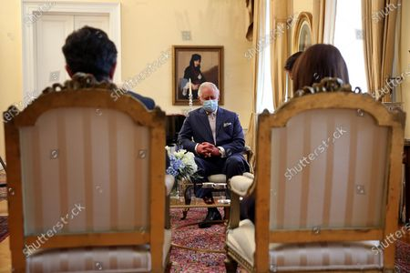 Greek President Katerina Sakellaropoulou (R) and her partner Pavlos Kotsonis (L) speak with the Britain's Charles, Prince of Wales, (C) and his wife Camilla, the Duchess of Cornwall (not seen) during their meeting in Athens, Greece, 25 March 2021, on occasion of the anniversary of the Greek Revolution. The anniversary events for the 200 years since the Revolution of 1821 are held with all formalities and the strict observation of all health protection measures against the coronavirus.