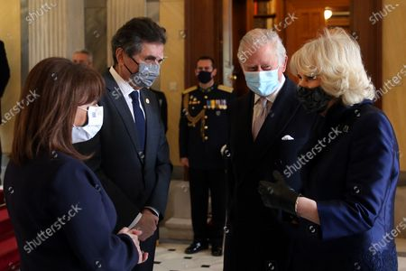 Greek President Katerina Sakellaropoulou (L) and her partner Pavlos Kotsonis (2-L) speak with the Britain's Charles, Prince of Wales, (2-R) and his wife Camilla, the Duchess of Cornwall (R) during their meeting in Athens, Greece, 25 March 2021, on occasion of the anniversary of the Greek Revolution. The anniversary events for the 200 years since the Revolution of 1821 are held with all formalities and the strict observation of all health protection measures against the coronavirus.