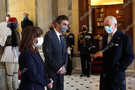 Greek President Katerina Sakellaropoulou (L) and her partner Pavlos Kotsonis (C) speak with the Britain's Charles, Prince of Wales, (R) during their meeting in Athens, Greece, 25 March 2021, on occasion of the anniversary of the Greek Revolution. The anniversary events for the 200 years since the Revolution of 1821 are held with all formalities and the strict observation of all health protection measures against the coronavirus.