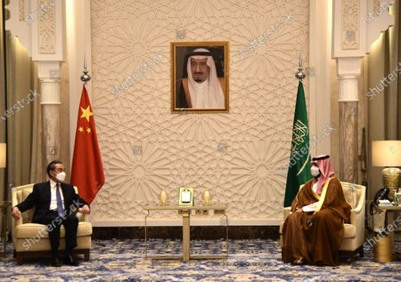 Saudi Arabia's Crown Prince Mohammed bin Salman bin Abdulaziz Al Saud (R) meets with visiting Chinese State Councilor and Foreign Minister Wang Yi in NEOM, Saudi Arabia, on March 24, 2021.
