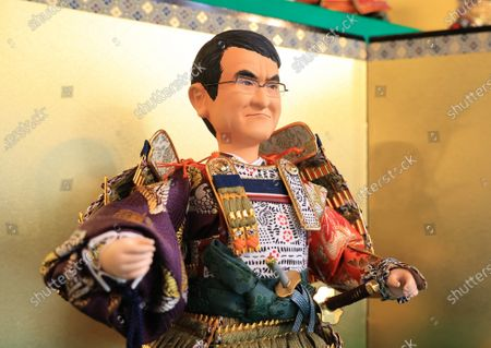 Japanese doll maker Kyugetsu displays a samurai doll of Japanese Administrative Reform Minister Taro Kono who is in charge of vaccination for the new coronavirus at the company's showroom in Tokyo on Thursday, March 25, 2021 to celebrate Children's Day on May 5. In Japanese tradition, parents decorate samurai dolls to wish their children may grow up to be health and robust.