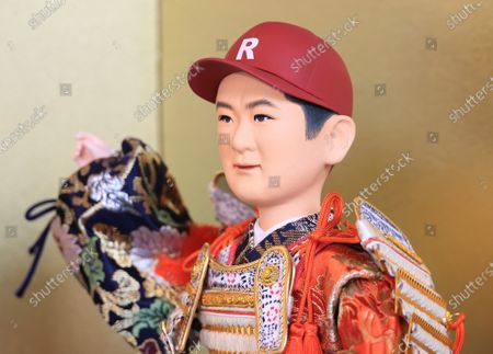 Japanese doll maker Kyugetsu displays a samurai doll of Japanese baseball pitcher Masahiro Tanaka who played major League Baseball for seven years and comes back to Japanese baseball league this season at the company's showroom in Tokyo on Thursday, March 25, 2021 to celebrate Children's Day on May 5. In Japanese tradition, parents decorate samurai dolls to wish their children may grow up to be health and robust.
