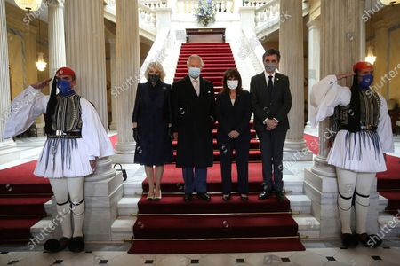 Greek President Katerina Sakellaropoulou, second right, her partner Pavlos Kotsonis, right, Britain's Prince Charles Charles, second left, and his wife Camilla, the Duchess of Cornwall pose for the photographers at the Presidential Palace in Athens, . Fighter jets flew by the ancient Acropolis and tanks rumbled past parliament in central Athens as Greece's celebrations for the bicentenary of the nation's war of independence culminated in a military parade attended by dignitaries from Britain, France and Russia but no public