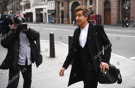 David Sherbourne (R) a lawyer representing US actor Johnny Depp arrives at the Royal Courts of Justice in London, Britain, 25 March 2021. US actor Johnny Depp has lost his attempt to appeal the verdict after he lost his case when suing The Sun's newspaper publisher News Group Newspapers (NGN) over claims he abused his ex-wife Amber Heard.