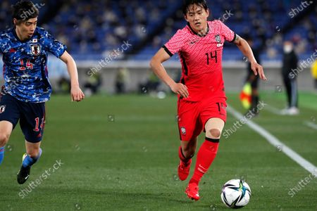 South Korea's Hong Chul, right, dribbles a ball chased by Japan's Junya Ito during their friendly soccer match at Nissan Stadium in Yokohama, Japan
