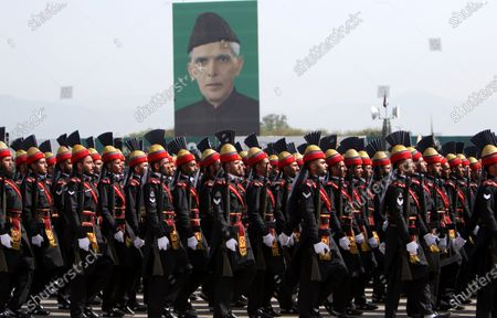Pakistani Frontier Corps (FC) soldiers pass by the portrait of Muhammad Ali Jinnah, founder of Pakistan as they parade to mark Pakistan National Day, in Islamabad, Pakistan, 25 March 2021. Pakistan celebrates its National Day to commemorate the adoption of the 1940 resolution demanding a separate state for the Muslims of then British-ruled India.