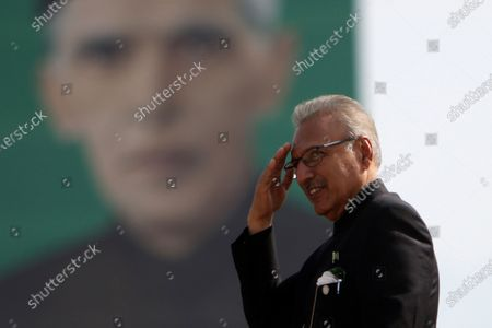Arif Alvi, President of Pakistan passes by the portrait of Muhammad Ali Jinnah, founder of Pakistan during the military parade to mark Pakistan National Day, in Islamabad, Pakistan, 25 March 2021. Pakistan celebrates its National Day to commemorate the adoption of the 1940 resolution demanding a separate state for the Muslims of then British-ruled India.