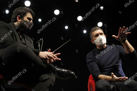 Antonio Banderas (R), along with Soho theater's musical director Arturo Diez Boscovich, chairs the presentation of the new Soho Pop Symphony Orchestra at the Soho theater in Malaga, Andalusia, southern Spain, 25 March 2021.