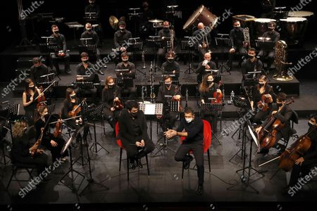 Antonio Banderas (C-R), along with Soho theater's musical director Arturo Diez Boscovich (C-L), chairs the presentation of the new Soho Pop Symphony Orchestra at the Soho theater in Malaga, Andalusia, southern Spain, 25 March 2021.