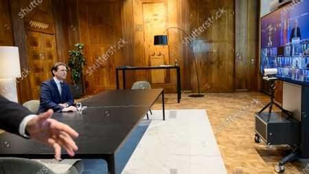 Austrian Chancellor Sebastian Kurz attends a video conference with EU leaders as European Council President Charles Michel and Portugal's Prime Minister Antonio Costa are seen on a screen, in Vienna, Austria, 25 March 2021.