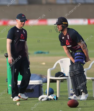 England's captain Eoin Morgan, left, talks with Jason Roy during a training session ahead of their second one-day international cricket match against India at Maharashtra Cricket Association Stadium in Pune, India