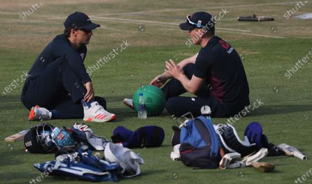 England's captain Eoin Morgan, right, speaks with Tom Curran during a training session ahead of their second one-day international cricket match against India at Maharashtra Cricket Association Stadium in Pune, India