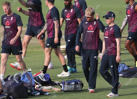 England's captain Eoin Morgan, right, speaks with Sam Curran during a training session ahead of their second one day international cricket match against India at Maharashtra Cricket Association Stadium in Pune, India