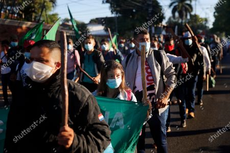 Farmers who are members of the National Farmer Federation (FNC) call for the resignation of President Mario Abdo Benitez over his handling of the coronavirus pandemic and the state of the public health system as they march in Asuncion, Paraguay
