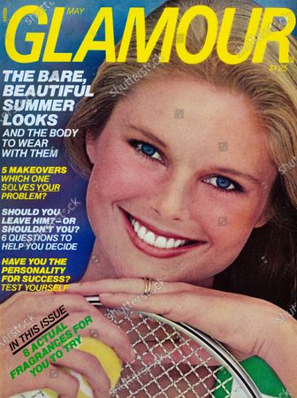 Stock Photo of Glamour May 01, 1976 Magazine Cover featuring: Christie Brinkley wearing Estée Lauder makeup and t-shirt from Stag White, with a tennis racket and tennis ball. Christie Brinkley