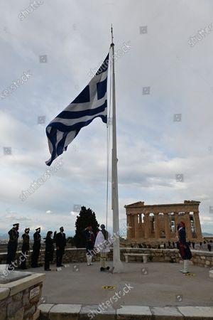 Greek President Katerina Sakellaropoulou (4th L) and Greek Prime Minister Kyriakos Mitsotakis (5th L) during the ceremony in Athens