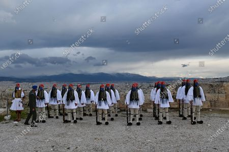 Presidential Guards stand by the Acropolis in Athens