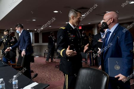 Special Operations Command Gen. Richard Clarke, left, and United States Senator Mark Kelly (Democrat of Arizona), right, speak following a hearing to examine United States Special Operations Command and United States Cyber Command in review of the Defense Authorization Request for fiscal year 2022 and the Future Years Defense Program, on Capitol Hill,, in Washington. Also pictured is Acting Assistant Secretary Of Defense For Special Operations And Low-Intensity Conflict Christopher Maier, second from left.
