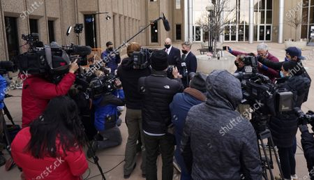 Boulder County, Colo., District Attorney Michael Dougherty, and assistant district attorney Ken Kupfner speak after a hearing for the suspect in Monday's mass shooting at a grocery store, outside the justice center in Boulder, Colo