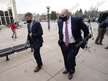 Boulder County, Colo., District Attorney Michael Dougherty, left, and assistant district attorney Ken Kupfner leave after speaking to the media about the hearing for the suspect in Monday's mass shooting at a grocery store, outside the justice center in Boulder, Colo