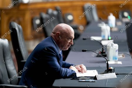 Sen. Mark Kelly, D-Ariz., speaks at a hearing to examine United States Special Operations Command and United States Cyber Command in review of the Defense Authorization Request for fiscal year 2022 and the Future Years Defense Program, on Capitol Hill,, in Washington, DC, USA, 25 March 2021.