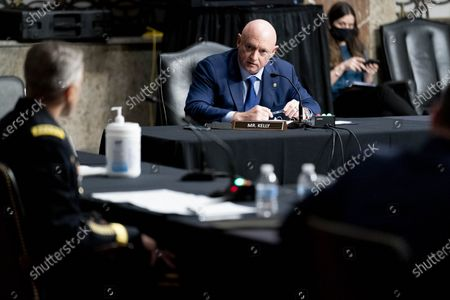 Sen. Mark Kelly, D-Ariz. (C) questions Special Operations Command Gen. Richard Clarke, (L) at a hearing to examine United States Special Operations Command and United States Cyber Command in review of the Defense Authorization Request for fiscal year 2022 and the Future Years Defense Program, on Capitol Hill, in Washington, DC, USA, 25 March 2021.