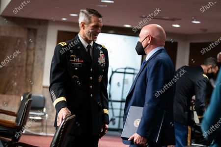"""United States Senator Mark Kelly (Democrat of Arizona), speaks to General Richard D. Clarke, USA, Commander, United States Special Operations Command, at the end of a hearing on the """"United States Special Operations Command and United States Cyber Command"""" with the Senate Armed Services Committee on Capitol Hill in Washington DC."""
