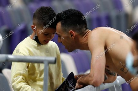 Eran Zahavi of Israel talks to a kid after the FIFA World Cup 2022 qualifying soccer match between Israel and Denmark in Tel Aviv, Israel, 25 March 2021.