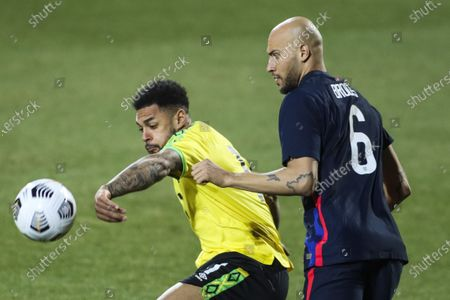 USA's John Brooks, right, duels for the ball with Jamaica's Andre Gray during the national anthem prior the international friendly soccer match between USA and Jamaica at SC Wiener Neustadt stadium in Wiener Neustadt, Austria