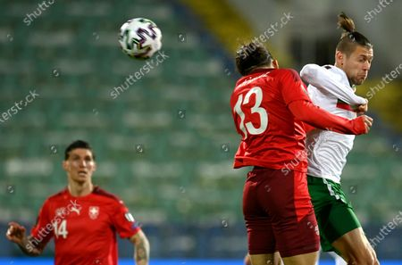 Bulgaria's Strahil Popov (R) in action against Switzerland's Ricardo Rodriguez (2-R) during the FIFA World Cup 2022 qualifying soccer match between Bulgaria and Switzerland in Sofia, Bulgaria, 25 March 2021.