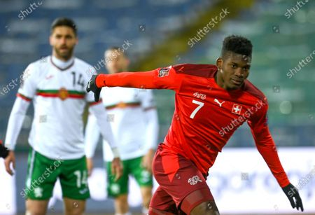 Switzerland's Breel Embolo (R) celebrates after scoring opening goal during the FIFA World Cup 2022 qualifying soccer match between Bulgaria and Switzerland in Sofia, Bulgaria, 25 March 2021.