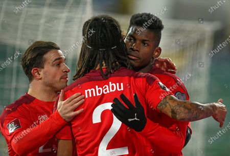 Switzerland's Breel Embolo (R) celebrates with teammates Xherdan Shaqiri (L) and Kevin Mbabu (C) after scoring the opening goal during the FIFA World Cup 2022 qualifying soccer match between Bulgaria and Switzerland in Sofia, Bulgaria, 25 March 2021.