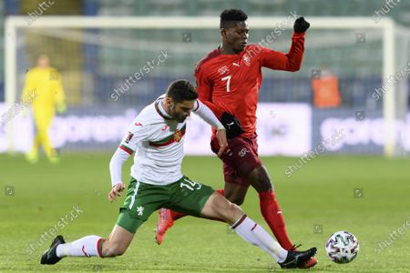 Stock Picture of Bulgaria's defender Daniel Dimov (L) fights for the ball against Switzerland's forward Breel Embolo during the FIFA World Cup 2022 qualifying soccer match between Bulgaria and Switzerland in Sofia, Bulgaria, 25 March 2021.