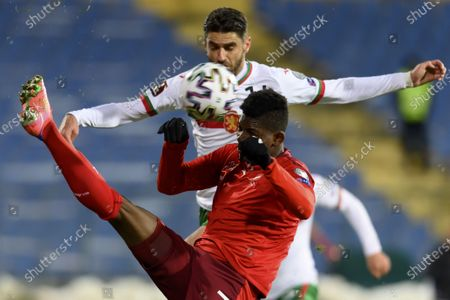 Stock Photo of Bulgaria's defender Daniel Dimov (rear) fights for the ball against Switzerland's forward Breel Embolo during the FIFA World Cup 2022 qualifying soccer match between Bulgaria and Switzerland in Sofia, Bulgaria, 25 March 2021.