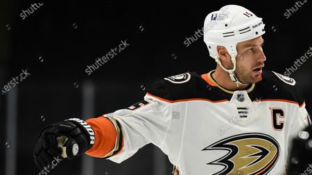 Anaheim Ducks' Ryan Getzlaf (15) prepares for a face-off against the Minnesota Wild during the second period of an NHL hockey game, in St. Paul, Minn