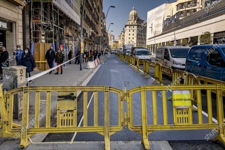 """Pelayo street is seen during the adaptation works for two new pedestrian lanes. The Barcelona City Council of the mayor Ada Colau applies """"emergency tactical planning"""" to recover for pedestrian use two of the vehicle lanes of the popular and commercial Pelayo street."""