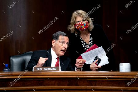 United States Senator John Barrasso (Republican of Wyoming) speaks to United States Senator Lisa Murkowski (Republican of Alaska) during a U.S. Senate Energy and Natural Resources Committee hearing at the Dirksen Senate Office Building on Capitol Hill in Washington D.C., U.S..