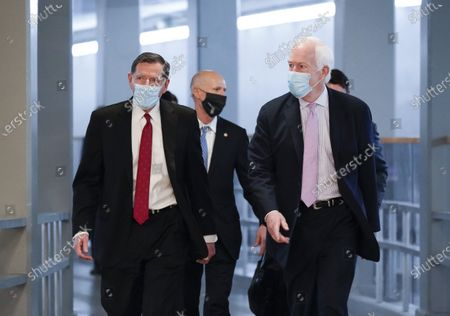 Sen.John Barrasso, R-Wyo., and Sen. John Cornyn, R-Texas, head to the chamber for votes, at the Capitol in Washington, . They and other Senate Republicans will be part of a delegation visiting the Texas-Mexico border in response to the immigration crisis there