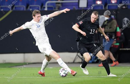 Iceland's Jon Dadi Bodvarsson, left, and Germany's Lukas Klostermann challenge for the ball during the World Cup 2022 group J qualifying soccer match between Germany and Iceland in Duisburg, Germany