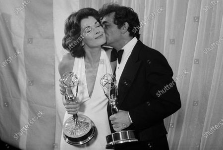 """Peter Falk of """"Columbo"""" gives Jessica Walter of """"Amy Prentice"""" a kiss after both won Emmys on May 19, 1975. Walter won for best actress in a limited series while Falk was named best actor in a lined series. Walter, who played a scheming matriarch in TV's """"Arrested Development,"""" has died. She was 80. Walter's death was confirmed, by her daughter, Brooke Bowman. The actor's best-known film roles included playing the stalker in Clint Eastwood's 1971 thriller, """"Play Misty for Me"""