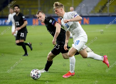 Stock Image of Germany's Lukas Klostermann (L) in action against Iceland's Albert Gudmundsson during the FIFA World Cup 2022 qualifying soccer match between Germany and Iceland in Duisburg, Germany, 25 March 2021.