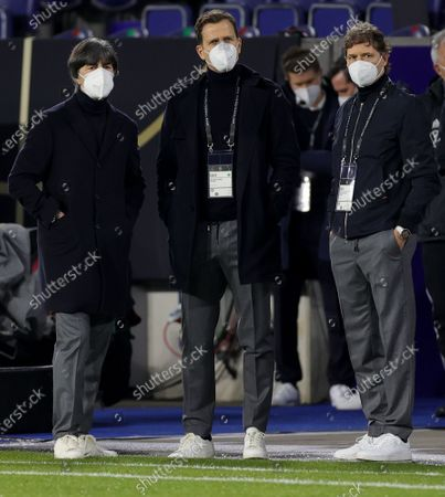 (L-R) Germany's head coach Joachim Loew , Germany's team manager Oliver Bierhoff and Germany's assistant coach Marcus Sorg prior to the FIFA World Cup 2022 qualifying soccer match between Germany and Iceland in Duisburg, Germany, 25 March 2021.
