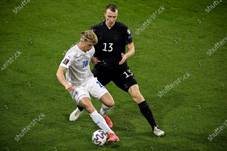 Iceland's Albert Gudmundsson (L) in action against Germany's Jonas Klostermann (R) during the FIFA World Cup 2022 qualifying soccer match between Germany and Iceland in Duisburg, Germany, 25 March 2021.